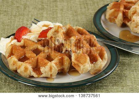 sweet waffles wit honey cream and strawberries