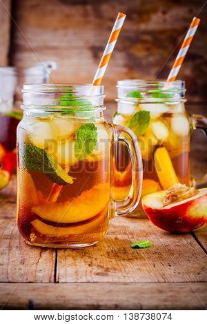 Peach Ice Tea In Mason Jar With Mint