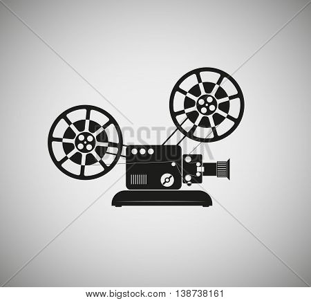 silhouette of the old film projecto rwith large reels of film