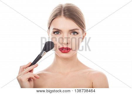 Beauty Girl with Makeup Brush. Beautiful Face. Makeover. Perfect Skin. Applying Makeup