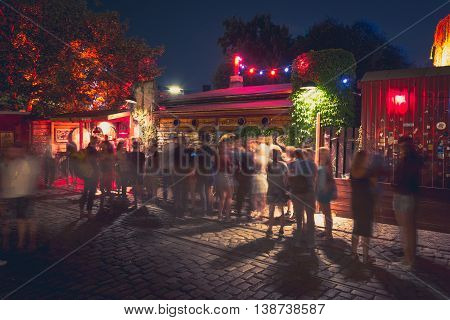 people at outdoor club in berlin at night