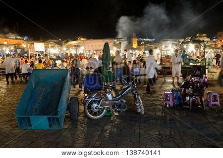 MARRAKESH - JULY 14: Unidentified people sells food in Jemaa el Fna Square at dusk, July 14, 2013 in a Marrakesh, Morocco. The square is part of the UNESCO World Heritage
