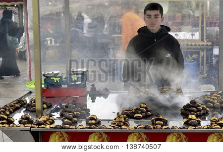 Istanbul Turkey - December 12 2012: Indispensable to Istanbul roasted chestnuts. Every season there in the streets.
