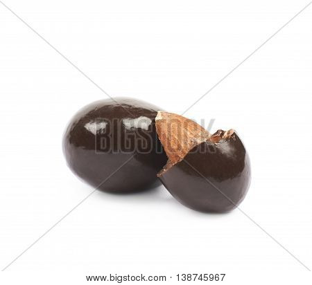 Chocolate coated almond nuts isolated over the white background