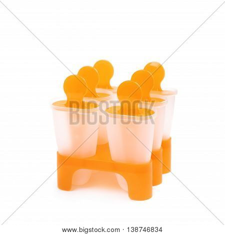 Plastic orange popsicle ice lolly form molds set isolated over the white background