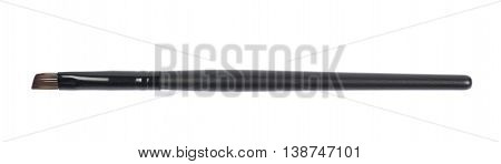 Black makeup brush isolated over the white background