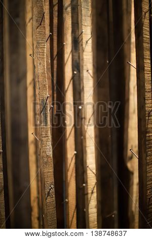 Thin timber strips with nails for hanging grapes to dry to produce sweet dessert wines