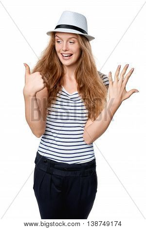 Hand counting - six fingers. Happy excited summer woman in straw fedora hat showing six fingers