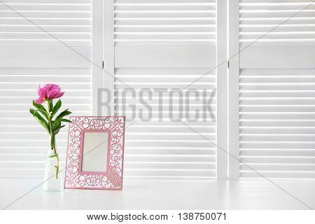 Beautiful peony flower on white folding screen background