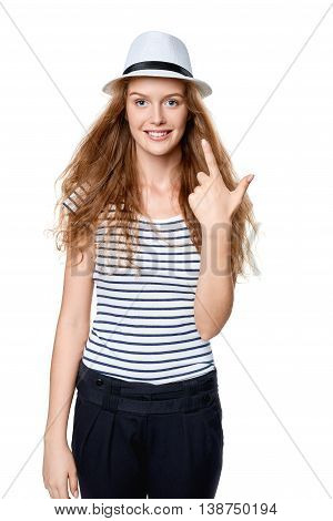 Hand counting - two fingers. Happy summer woman in straw fedora hat showing two fingers