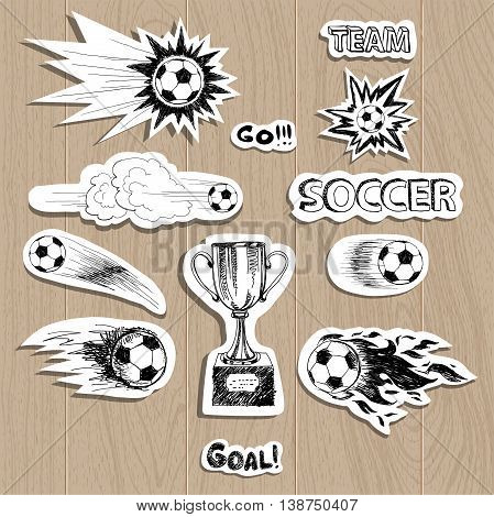Soccer stickers set on wood background with ball