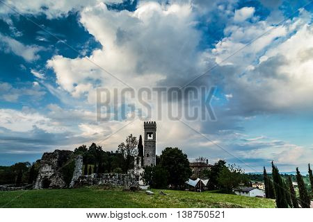 Storm Over An Ancient And Ruined Castle In The Italian Countryside