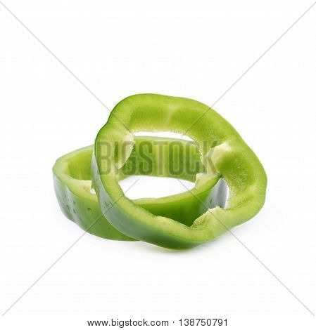 Pile of a green bell pepper slices isolated over the white background
