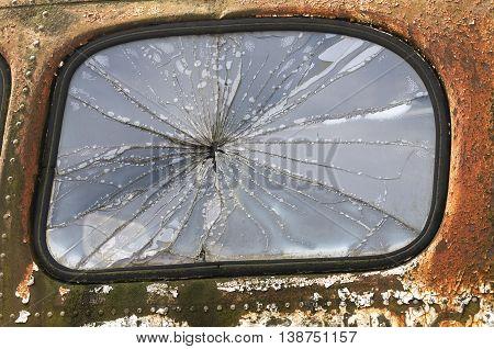 Extensive damage to door of old pickup truck