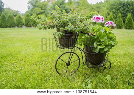 beautiful elegant decorated stand for flowers in the form of a Bicycle