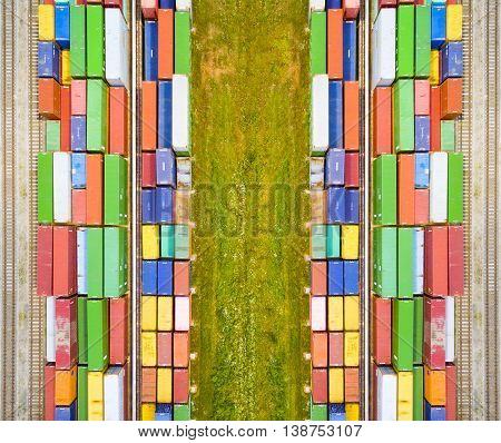 Aerial view of containers at railway near green field. Industrial background. Industry from above. Environment and transportation.