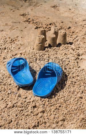 beach slippers on the sea coast .