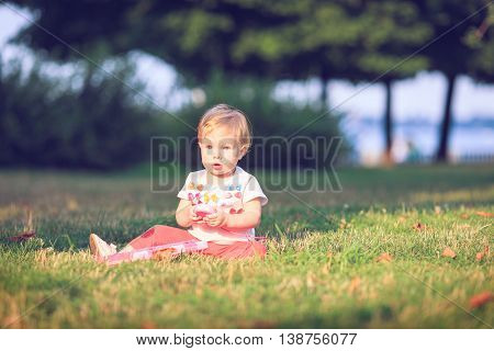 Baby playing on Outdoors. Computer mouse in hand.