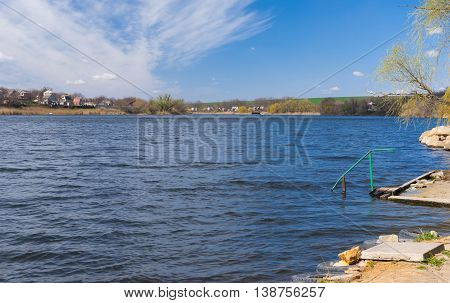 Early spring landscape with small Ukrainian river Sura