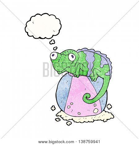 freehand drawn thought bubble textured cartoon chameleon on ball