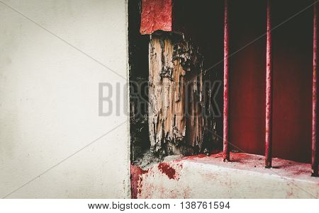 Old Wood window frames decaying, red painted