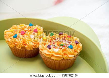 cheese cream cupcakes with sprinkled marble topping