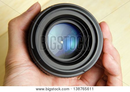 Hand hold camera dslr lens with nice lighting shining on the lens