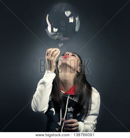 girl with a bubble in a black backgroud