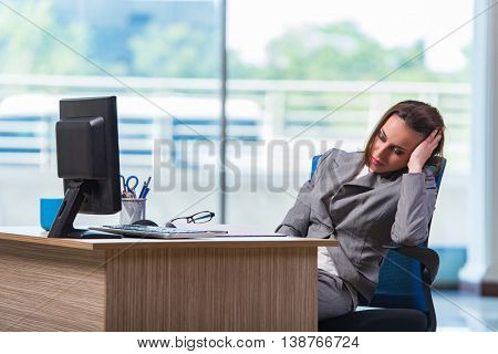 Young businesswoman tired after long working day