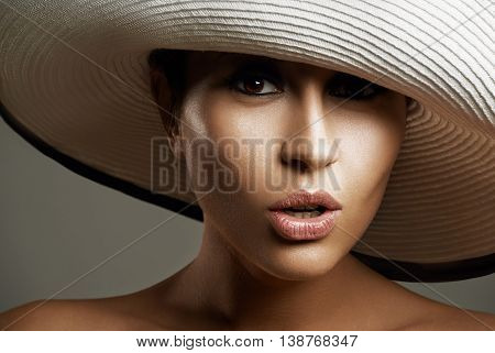 Beauty Woman In A Hat. Beautiful  Model Girl With Perfect Fresh Clean Skin. Youth And Skin Care Conc