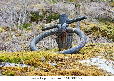 Old anchor ring found on a island. Set in rock. Used to anchor ships but not used anymore.