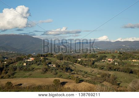 Hills of Sabina with foreground trees and sunny skies