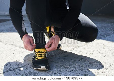Mens hand tie the laces on sneakers