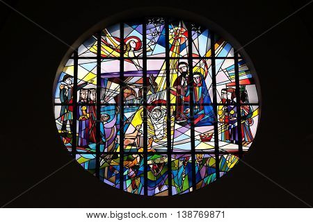 KLEINOSTHEIM, GERMANY - JUNE 08: Nativity Scene, stained glass window in the Saint Lawrence church in Kleinostheim, Germany on June 08, 2015.