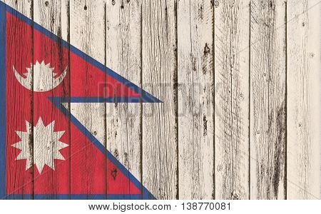 Flag of Nepal painted on wooden frame