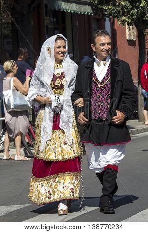 SELARGIUS, ITALY - September 14, 2014: Former marriage Selargino - Sardinia - married couple parading in traditional Sardinian costume