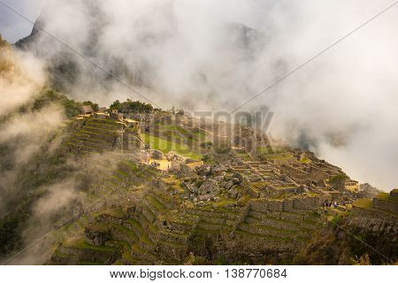 Machu Picchu Illuminated By The First Sunlight Coming Out From The Opening Clouds. The Inca's City I