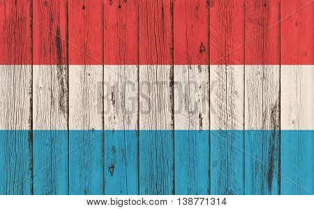 Flag of Luxembourg painted on wooden frame