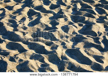 The background created by sandy beach can be seen in the light of the setting sun in Kolobrzeg in Poland