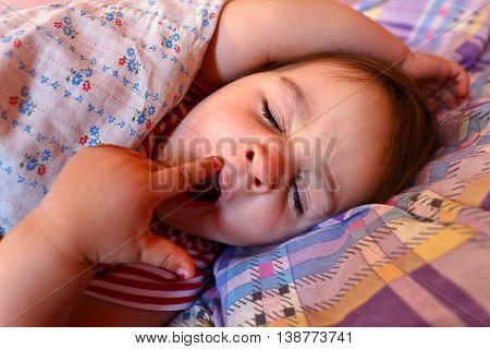 Closeup portrait of little yawning sleeping girl