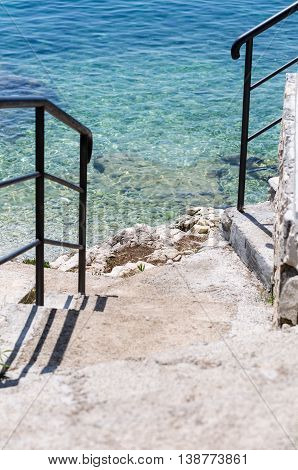 Croatia seaside with stairways to clear water