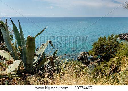 Tuscany maremma coastline with blue sky and water