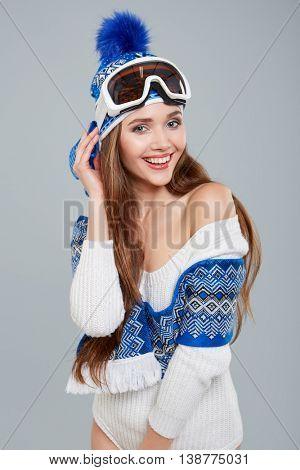 woman in sports thermal body for skiing training ski googles studio shot
