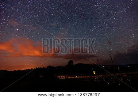deep sky astrophoto. fantastic winter meteor rain and mountains in the mist.
