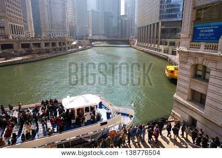 CHICAGO, IL - CIRCA MARCH, 2016: Chicago River in the daytime. The Chicago River is a system of rivers and canals that runs through the city of Chicago, including its center.