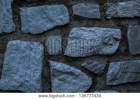 Blue and silver stone wall in the garden