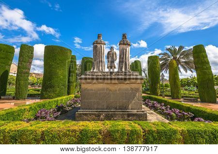 The statues of Catholic Monarchs and Christopher Columbus inside the popular gardens of Alcazar de los Reyes Cristianos. Cordoba, Andalusia, Spain.