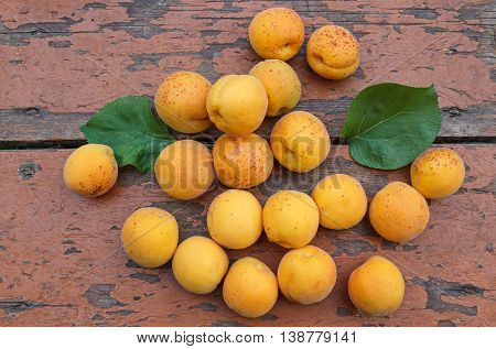 Ripe apricots on an old wooden surface. Fruit