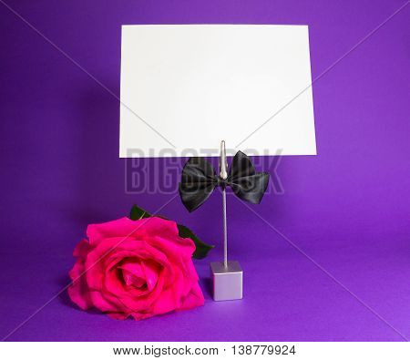 Note holder with the male butterfly with rose and empty card on blue
