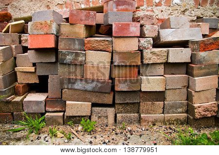 clay bricks of different color and type ready to be used to build walls